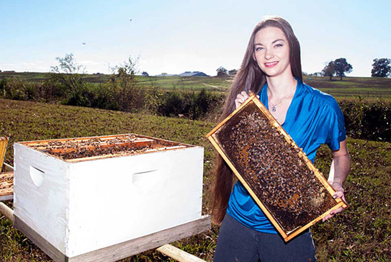 Heather Blackwell with bee hive