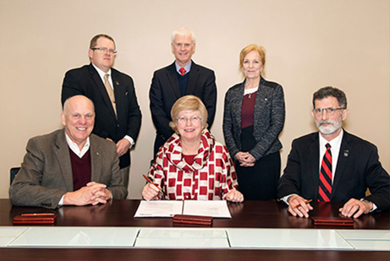 Officials sign Cooperative Agreement