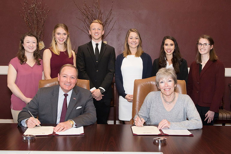 officials and students sign proclamation