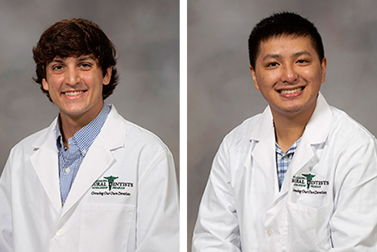two MSU students in white coats