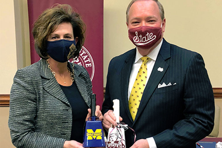 Mary Graham and Mark Keenum with cowbells