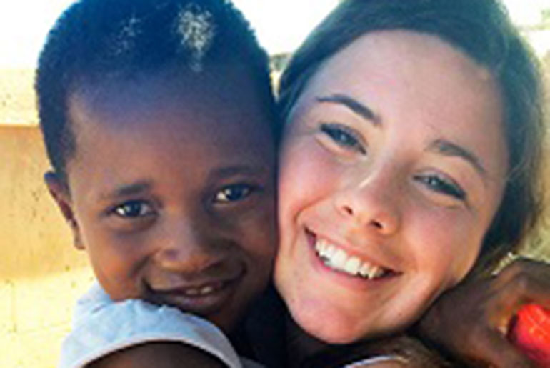 Shelbie Dalton with South African child