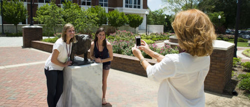 Parent taking picture of students with Bully